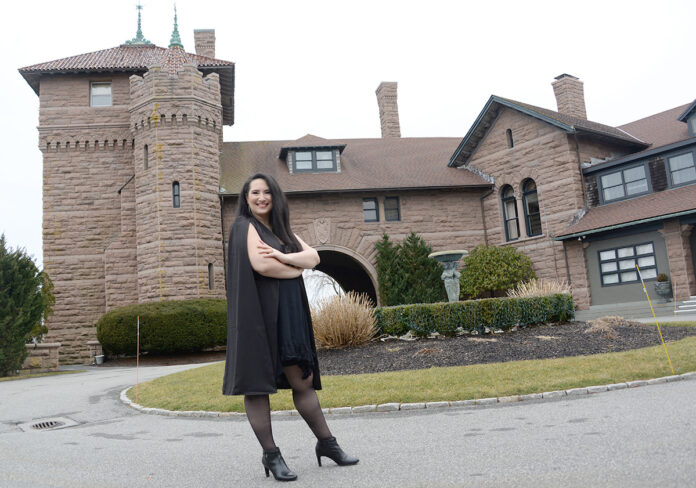PLANNING AHEAD: While large weddings being planned by Angelic Affairs LLC are still scheduled for this summer and fall in Newport, owner Kelly Teves, pictured in front of the OceanCliff Hotel in the city, says three of her clients that had originally booked dates in 2020 have moved them to 2022 and she's already getting inquiries about 2023. / PBN PHOTO/ELIZABETH GRAHAM