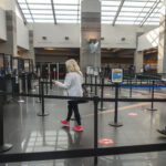 A FEW TRAVELERS make their way through the security line in the terminal at T.F. Green Airport. Airport officials hope legislation to change the name of the airport will help boost the number of passengers who come through the state's largest airport. / PBN FILE PHOTO/MICHAEL SALERNO