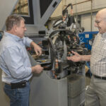 DYNAMIC DUO: Anthony Squillacci Jr., left, president of APAC Tool Inc., took over the family business, which was started as a jewelry manufacturer by his father, Anthony Squillacci Sr., right. APAC now also does product design. / PBN PHOTO/MICHAEL SALERNO