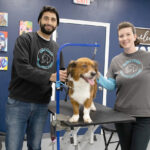 POOCH PASSION: Former graphic designer Aldo Abreu, left, now uses his expertise to groom pets after opening Chibi's Choice Pet Grooming & Supply in East Providence with his wife, Megan, right. / PBN PHOTO/RUPERT WHITELEY
