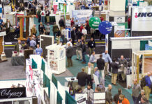 ATTENDEES AND EXHIBITORS interact at a past Northeastern Retail Lumber Association expo hall at the R.I. Convention Center in Providence. Gov. Daniel J. McKee announced Thursday that the convention center, which has been closed since March 2020 due to the COVID-19 pandemic, is slated to reopen in August. / COURTESY NORTHEASTERN RETAIL LUMBER ASSOCIATION