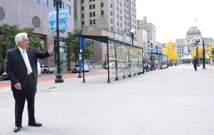 PETER ALVITI JR., director of the R.I. Department of Transportation, stands in Kennedy Plaza in Providence last year and explains where new bus stops are planned as part of RIDOT's planned Providence Multi-Hub Bus System. / PBN FILE PHOTO/ELIZABETH GRAHAM