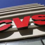 CVS Health has announced it will reopen its headquarters in Woonsocket in September. / AP FILE PHOTO/GENE J. PUSKAR