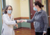 IN GOOD HANDS: Jennifer Beaugh, right, pharmacy supervisor at The Miriam Hospital, hands a dose of COVID-19 vaccine to Dr. Karen Tashima at a clinic at The Miriam. Tashima is overseeing a clinical trial of the COVID-19 vaccine that hasn't yet received U.S. government approval.  / COURTESY LIFESPAN CORP.