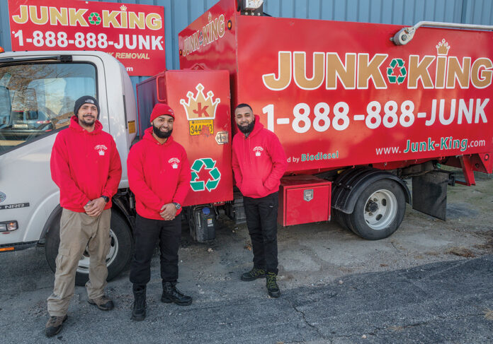 TEAM EFFORT: Junk King, located in Cranston, offers full-service furniture and appliance removal. From left, Matthew Rodriguez, manager, and owners Jose Martinez and Joel Martinez.PBN PHOTO/MICHAEL SALERNO