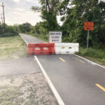 """FOR 18 MONTHS, signs in Warren and Barrington have detoured cyclists and walkers off the East Bay Bike Path because of two unsafe bridges. Grow Smart Rhode Island says it's an indication that the R.I. Department of Transportation has put a low priority on """"active transportation"""" infrastructure. / PBN PHOTO/WILLIAM HAMILTON"""