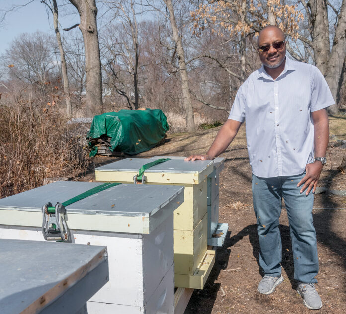 HOMEMADE HONEY: Calvin Alexander opened Bailey Beattie Apiaries LLC after starting beekeeping as a hobby and expanding into 10 active hives in production. PBN PHOTO/MICHAEL SALERNO