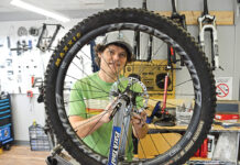 ATTENTION TO DETAIL: Mike Galoob, owner of Mythic Bike Works LLC in South Kingstown, repairs a bike in his shop. / PBN PHOTO/ELIZABETH GRAHAM