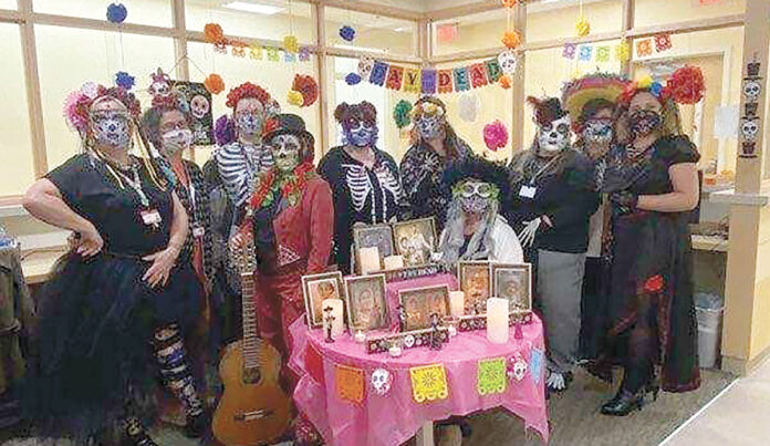 HEALTHY HALLOWEEN: Brown Medicine employees gather and dress in costume during a 2020 Halloween contest. / COURTESY BROWN MEDICINE