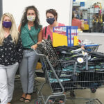 OUT SHOPPING: Navigant Credit Union employees went shopping for backpacks and school supplies, which were provided to the families of The Izzy Foundation. / COURTESY NAVIGANT CREDIT UNION