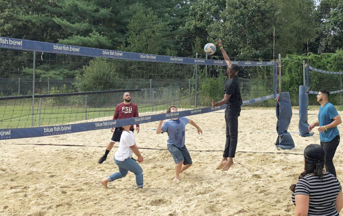 HAVING A BALL: The College Crusade of Rhode Island staff members face off in a volleyball game during Staff Appreciation Day at Mulligan's Island in Cranston. / COURTESY THE COLLEGE CRUSADE OF RHODE ISLAND