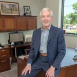 OPENING THE DOOR: Frederick Reinhardt, CEO and president of Greenwood Credit Union, says the Warwick credit union started providing services to cannabis-related businesses in part because of safety concerns over operating a large all-cash enterprise. / PBN PHOTO/MICHAEL SALERNO