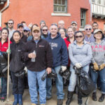 NICE AND TIDY: Rhode Island Foundation employees and their families perform a community cleanup. / COURTESY RHODE ISLAND FOUNDATION