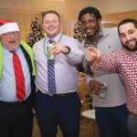 HOLIDAY CHEER: Rite-Solutions Inc. employees get into the spirit at a recent holiday company party. / COURTESY RITE-SOLUTIONS INC.