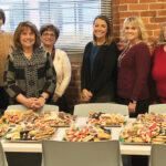 NICE TREATS: Sansiveri, Kimball & Co. LLP employees gather at a recent cookie swap. / COURTESY SANSIVERI, KIMBALL & CO. LLP