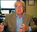 John Wareen, CEO, is enthusiasticfor bank's future. (H. Johnson)