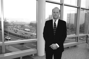 Providence Police Chief Dean M. Esserman at police<br>headquarters, with Route 95 in the background.