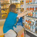 Jackie Umbraico stocks the shelfat Douglas Wine & Spirits onAtwood Ave. in Cranston