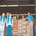 Members of Girl Scout troops recently received theircookies at a warehouse in West Warwick.