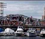 Boats at rest are lined up below<br>the Point Street Bridge in<br>Providence.