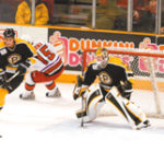 P-Bruin defensemen Milan Jurcina clears the Bruins' zone. The team is not anticipating an attendance boost despite the NHL lockout.