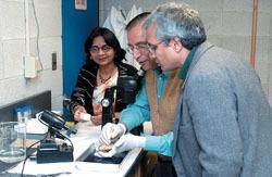 UMass Dartmouth professor Dr. Bal Ram Singh, above right, with colleages from India, Dr. V.K. Das, center and Dr. Shobna Das.
