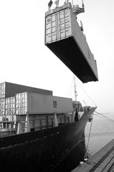 <b>Photo courtesy of Bloomberg News</b><br>In northern France, a container is loaded onto a cargo ship in this Bloomberg News file photo. European Union officials are challenging certain U.S. trade tax clauses that affect many of their imports.