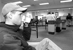 <b>Photo by Dan Hunt</b><br>A customer enjoys a cup of coffee at Bank Rhode Island's Pitman Street branch in Providence, one of three locations where the bank has set up