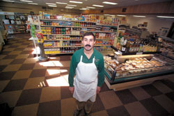 <b>Photo by Brian McDonald</b><br>Westerly deli owner, Tony Spino, has has to compete with a nearby Wal-Mart SuperCenter.