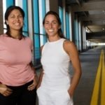 IN PROGRESS: On-site at the Providence Place mall parking garage - where they're working to minimize motorists' confusion and anxiety - are Multi Design for People LLC co-owners Rosanne Ramos, left, and Kat Darula. /