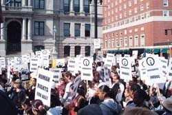 JANITORS, hotel workers and others gather in front of Providence City Hall for a May 1 rally organized by UNITE HERE! Local 217 and Service Employees International Union Local 615 to support contract negotiations and the national immigrant rights movement. /