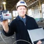 ALAN TEAR demonstrates one RI-WINs application, a way to record public safety inspections using wireless technology. /
