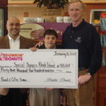 SPECIAL OLYMPICS Rhode Island Executive Director Michael McGover, left, and athlete Michael Luca with Dunkin' Donuts franchisee Rob Batista, whose shop in North Kingstown raised $648 during this winter's promotion. /
