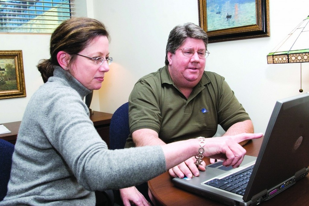 TOM O'BRIEN, right, manager of the EDS facility in Warwick, discusses electronic health records visuals with a project manager, Beth Perry. /