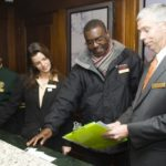 DAN WILLIAMS, who took over as general manager at the Providence Biltmore Hotel four months ago, reviews the day's activities with some of his staff. /