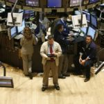 TRADERS WORK the floor of the New York Stock Exchange yesterday, when 'extraordinary heavy trading' erased this year's gains and caused problems with Dow Jones, NYSE and Nasdaq data reporting. /