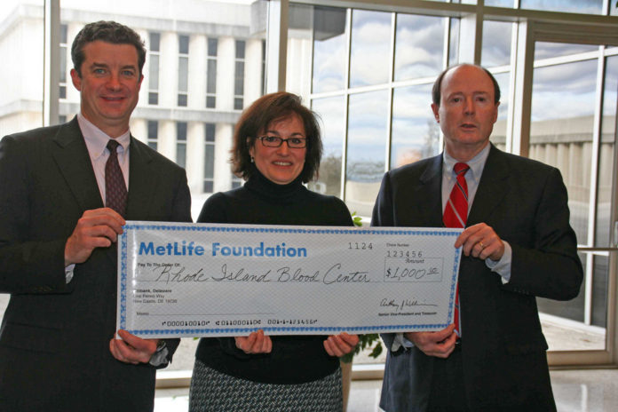 METLIFE Auto & Home President Bill Mullaney, left, and blood coordinator Collette Berthiaume, center, present the MetLife Foundation grant to Rhode Island Blood Center President and CEO Lawrence Smith. /