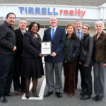 MILLIE WRIGHT, third from left, loan officer for Rhode Island Housing, with, from left, Gil Medeiros, Skip Gilmore, Phil Tirrell, Jennifer Feighery, Bill Tirrell, Stephanie Duggan and Louanne Jennings, all of Tirrell Realty. /