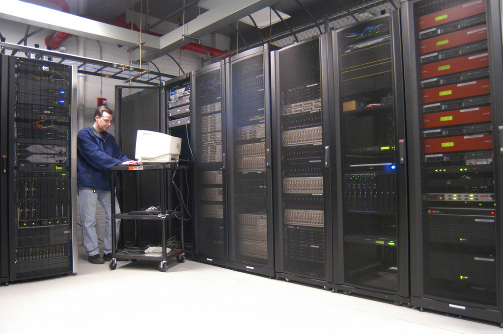 THE COMPANY'S DATA CENTER on Westminster Street in Providence provides services from Internet access and e-commerce to data backup and disaster recovery. Above, Gary Manning, HostTech's chief technical officer, monitors systems in the main server holding area. /