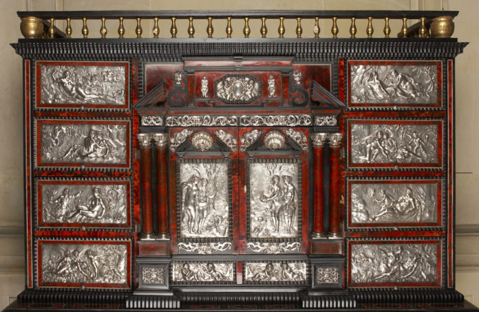 A 17th-CENTURY Flemish Baroque silver- and brass-mounted ebony, red tortoiseshell and giltwood cabinet is one of several antique pieces now on display at The Elms in Newport after being donated by private collectors Annette and Dr. Sam Mandel. /