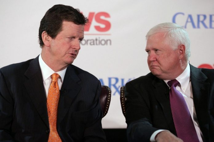 THE CVS/CAREMARK merger proposal announced in November by Thomas M. Ryan, left, president and CEO of CVS, and Mac Crawford, his  Caremark Rx counterpart, has won the endorsement of advisory service ISS. /