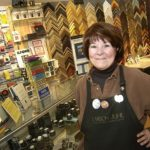 THE CAMERA WERKS owner Patricia Zacks keeps her business alive with good, old-fashioned customer service and offerings like custom framing; instead of photo developing, she now offers a digital photo printing station. /