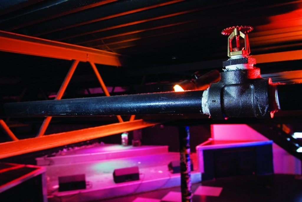 FOR MANY R.I. BUSINESSES the new fire code boils down to cost, with sprinkler systems and alarms costing upwards of tens of thousands of dollars. /