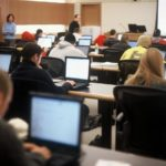 STAYING FOCUSED: Bryant University students are engaged in an information resources technology class, in the George E. Bello Center for Information and Technology. /