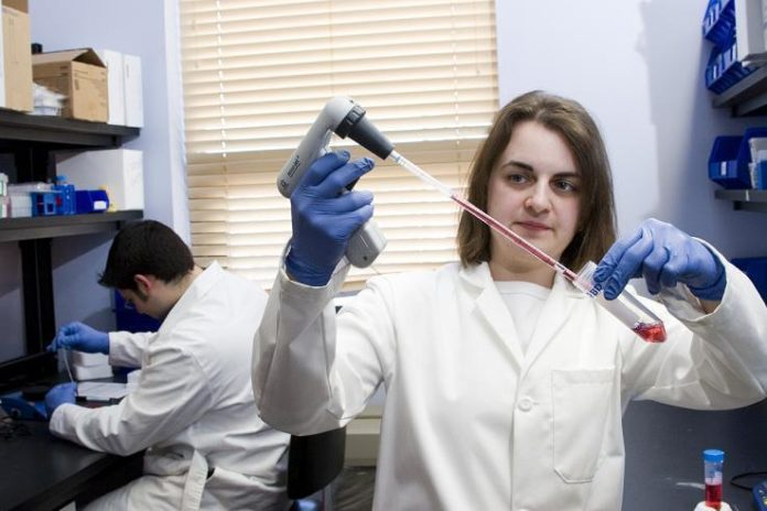 DR. CHRISTINE MALBOEUF samples different mediums at EpiVax, a Providence biotech firm that is using computerized gene sequencing to help develop vaccines. /