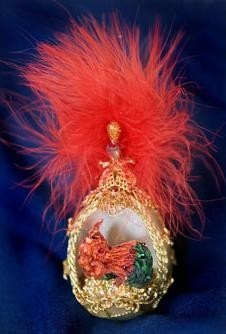 THE 2007 STATE EGG features Swarovski crystals and gold findings  on a pearlized egg, and contains a sculpted Rhode Island Red. /