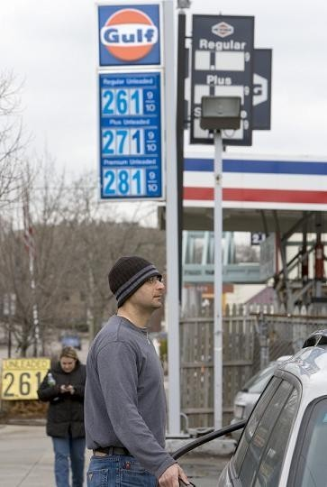 AT A GAS STATION in Newton, Mass., last month, an attendant fuels a customer's car. /