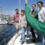 CRUISING WORLD and Sailing World staff members, from left, Mark Pillsbury, CW senior editor; Elaine Lembo, CW managing editor; John Burnham, CW editor and SW editorial director; and Dave Reed, SW editor, aboard a boat at the Newport Marina. /