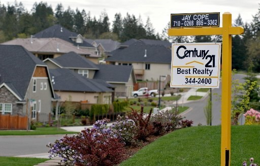 THERE'S NO FEE for the application, loan origination, appraisal or title under the new program, which requires a 5% down payment. Above, a for-sale sign stands outside a house in Eugene, Ore., late last month. /