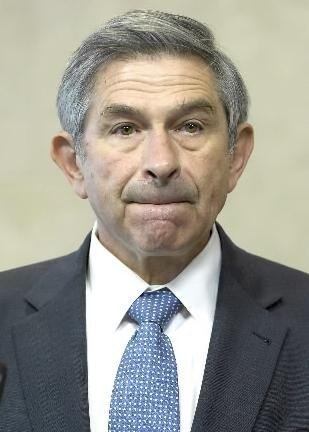 PAUL WOLFOWITZ, 63, the beleaguered World Bank president, fields questions last Wednesday in Belgium. /